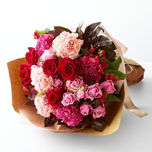 赤バラとピンクのカーネーションのブーケの画像
